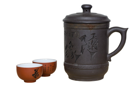chinese teapot: Isolated brown chinese teapot and tea cup. Stock Photo