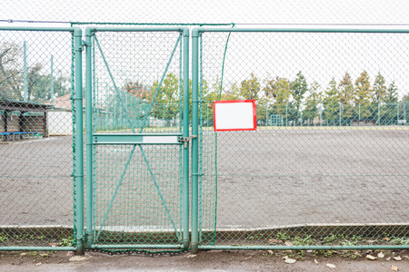 locked: Locked green metal mesh door