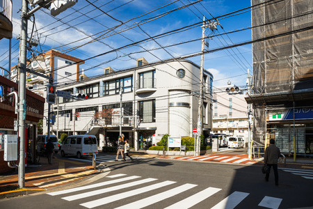lowrise: Tokyo, Japan - Nov 16, 2015 : View of local town in Tokyo, Japan. There have low-rise building and a large number of wire.