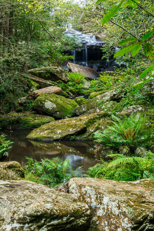 Waterfall in jungle with stone Stock Photo