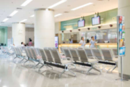 private hospital: Blurry dispensing area in private hospital with row of chair Stock Photo