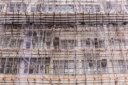 Jordan, Kow Loon - October 23, 2016 : Traditional way of scaffold is to use a hundred of bamboo to weave together and use net for safety.