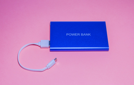 Power bank for charge telephone on pink background-image Archivio Fotografico