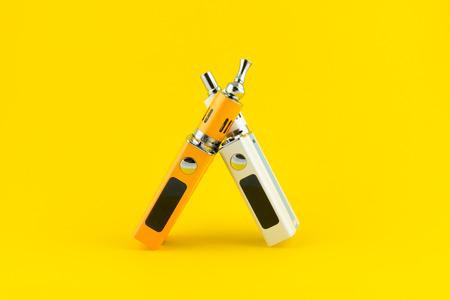 mod: Electronic Cigarette mod closeup on yellow background. Stock Photo