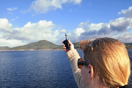 Woman Holding a Vape