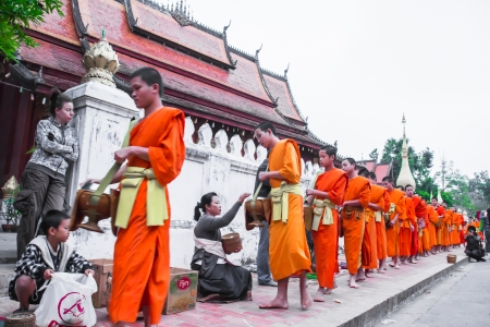 Morning at Luang Prabang for Buddhist offer some food to monk