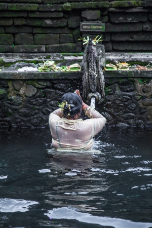 Holy water Pura Hindu in Bali Indonesia photo