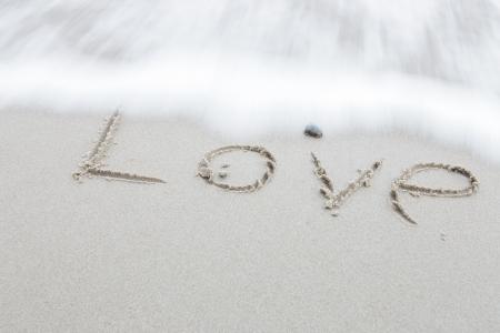 valentine s day beach: wording Love on sand beach background
