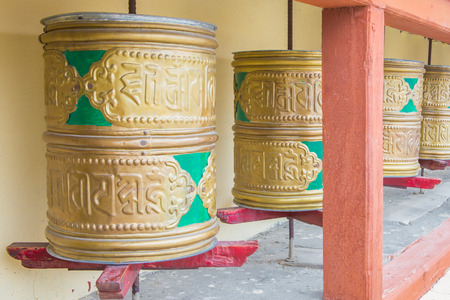 Buddhist prayer wheels in Tibetan monastery with written mantra. India, Himalaya, Ladakh photo