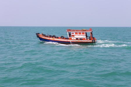 Fisherman boat on sea photo