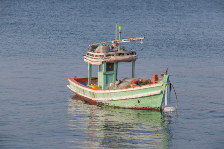 fisherman on boat: Fisherman boat on sea