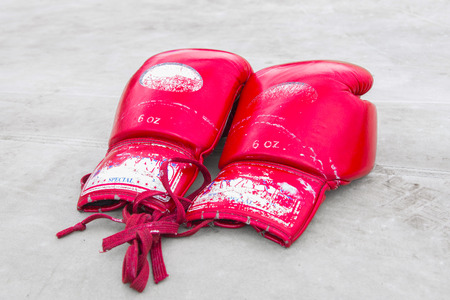 A pair of bright red Muay Thai boxing on ground stage boxing photo