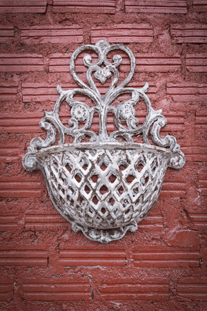 Vintage wall with basket candel photo