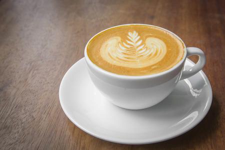 Coffee latte art on wood table Stock Photo - 32041045