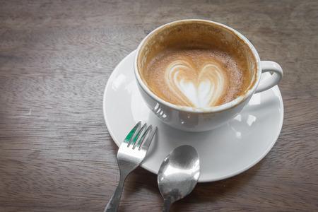 drank: Latte art coffee heart milk design , half drank in the cup