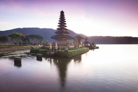 gr: Pura Ulun Danu Hindu temple at morning with sunset  in Bali Indonesia