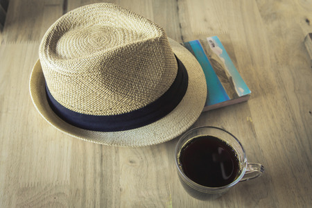 Coffee with book and hat journey photo