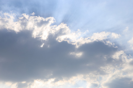 greenish blue: clouds with sun rays Stock Photo