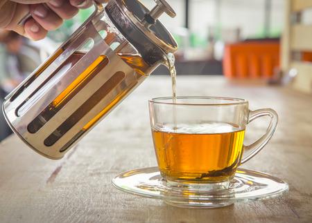 Cup of tea with tea pot