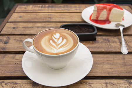 cafe latte: A cup of cafe latte and cake Stock Photo