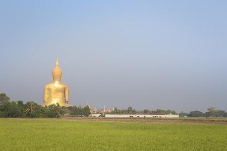 gr: Buddha Statue in Thailand on rural landscape