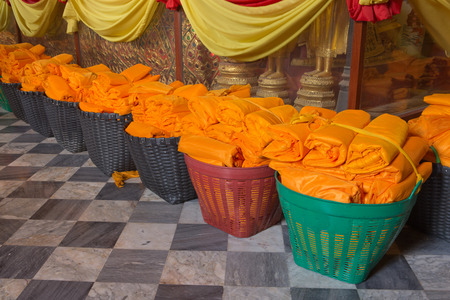 AYUTTHAYA, THAILAND - Febbuary 16: People work with cloth on Buddha image in Wat Phanan Choeng temple on Febbuary 16, 2015 in Ayutthaya, Thailand. Ayutthaya is former capital of Siam (former Thailand). photo