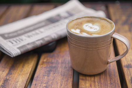 coffee latte with a newspaper photo