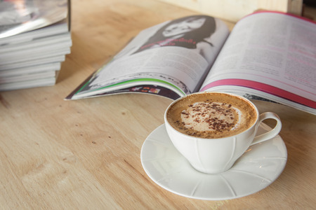tabel: Cup of coffee cappuccino with books on tabel Stock Photo