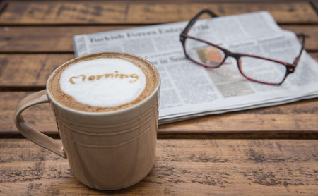 daily newspaper: Morning cup of coffee  and newspater with grasses