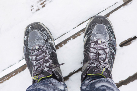 hiking shoes: Hiking shoes on snow ,top view and selective focus