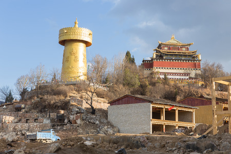 shangrila: A view of Shangri-la , Biggest holy wheel monastery and in front of fire burned city in January 2014