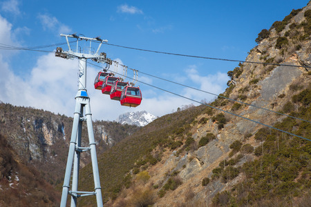 shangrila: Group of cable car cabins in blue moon valley Shangrila China