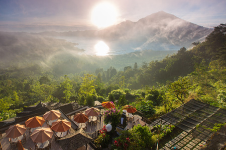 gr: Sunrise over the valley with villages and lake situated in caldera of old giant volcano. Bali, Indonesia
