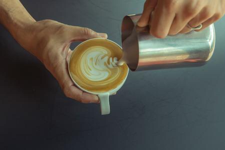 pouring milk make latte art coffee Archivio Fotografico
