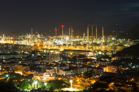 refinement: Oil refinery plant area at middle city in night Stock Photo