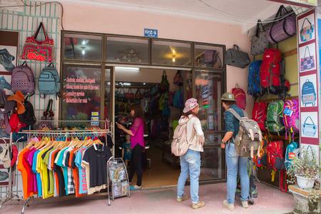 insist: SAPA, Lao Cai, Vietnam -16 June 2015: Shop of trekking at market of Sapa. Selling bagpack and suite for traveler , Sapa ,Northern of Vietnam , June 16- 2015.