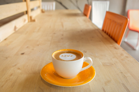 love pic: Latte Art coffee with  Love    wording on table at coffee shop Stock Photo