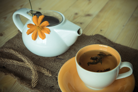 trivet: Tea in the cup with tea pot  on table , retro picture style