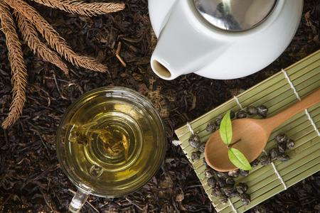 trivet: a cup of tea with tea pot and tea set on dry tea Stock Photo