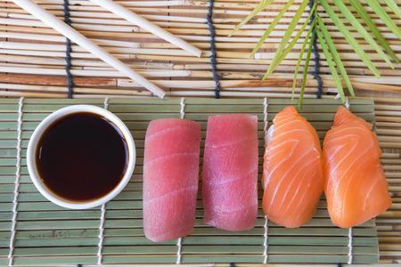 sushi chopsticks: Sushi set with chopsticks and sauce on bamboo table