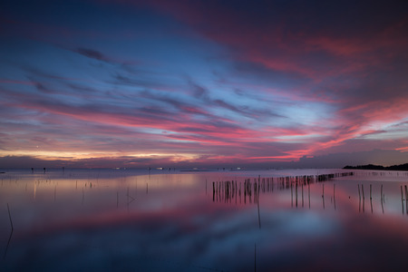 sunset clouds: Fantastic colorful sunset and dark ominous clouds above the sea in Thailand Stock Photo