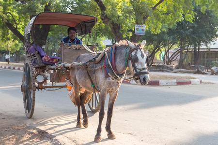 horse cart: BAGAN-MYANMAR ,December 14,2015 ;  Horse cart at main road of  Bagan. The cart is  famous vehicle from people . December 14, 2015 in Bagan, Myanmar(Burma) Editorial