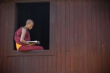 recite: BAGAN, MYANMAR Dec 13: a young novice stydying at window of chamber temple on Dec13,2015 in Bagan, Myanmar. Boys at 8-20 years old have to enter the Buddhist Order as a novice. Editorial