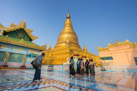 banian tree: Mandalay , MYANMAR - Dec 9 : The main Golden Pagoda of Sagaing hill . Sagaing hill is famous temple many Burmese visit on Dec 9, 2015 . Mandalay ,Myanmar(Burmar)