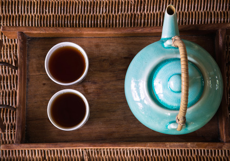 sparce: traditional eastern teapot and teacups on wooden desk