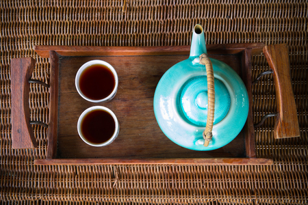 teacups: traditional eastern teapot and teacups on wooden desk