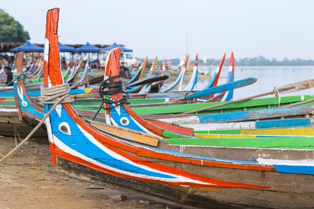 boatman: Head of local boat on Amarapura lake at U Beig bridge , Tradition decoration boat Stock Photo