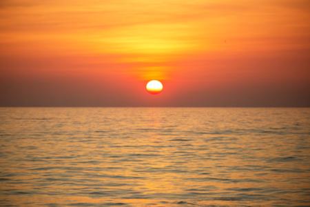 orange sunset: Blurred ofl sunset above the sea