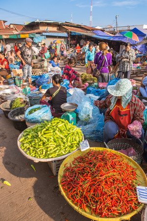 laotian: Vientiane,Laos- Jan 17 ;Many Vendors and costumer  of Lao selling and buying local food and product in Morning Market Vientiane on January 17,2016 . Vientiane , Laos .