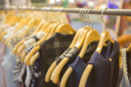 closet rod: Wooden clothes hangers with blur and vignette background Stock Photo